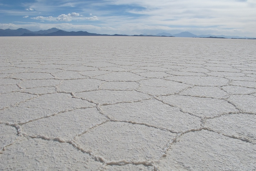 Salar de Uyuni.  I'm sure one of our science-nerd friends can tell us about the pentagonal salt-crust patterns!