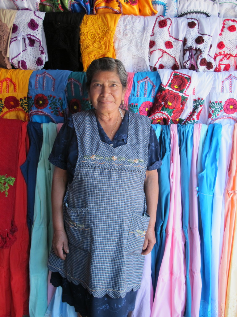 Shopping for aprons worn by the Zapotec women.  Who could resist buying an apron from this beautiful woman?